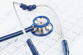 stock photo of ecg chart  - Stethoscope over ecg graph  - JPG
