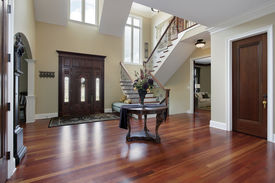 image of entryway  - Foyer in luxury home with cherry wood flooring - JPG