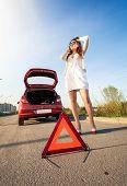 image of breakdown  - Sexy woman calling mechanic after car breakdown - JPG