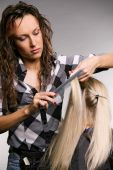 Professional Hairdresser Doing Haircut