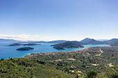 foto of scorpio  - landscape of the beautiful nidri and small island scorpios of leukada in Greece - JPG