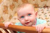 foto of bassinet  - Happy Little Baby Portrait in Bassinet closeup - JPG