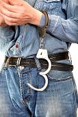 foto of forgiven  - Man with Unlocked Handcuffs on a Hand - JPG