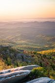 stock photo of blue ridge mountains  - Sunrise over the Blue Ridge Mountains at the Rough Ridge Overlook right off the Blue Ridge Parkway - JPG