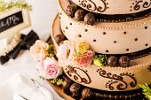 stock photo of centerpiece  - Gourmet tiered wedding cake at wedding reception.