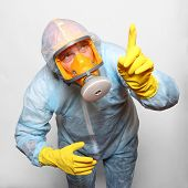 picture of respiration  - Man in protective clothing with respirator - JPG