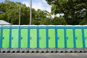 stock photo of septic  - row of portable toilets for park outdoor - JPG