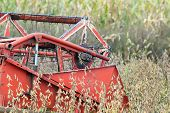 stock photo of combine  - Close up of combine harvester working in soybean field - JPG
