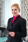 pic of housekeeping  - Housekeeping manager or assistant controlling hotel suit or suit with checklist on tidiness  - JPG