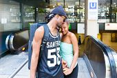 stock photo of long distance relationship  - African man leave girlfriend at railway station - JPG