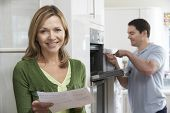 picture of receipt  - Satisfied Female Customer With Oven Repair Bill - JPG