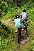 stock photo of dirt-bike  - two children running bike in a woods - JPG