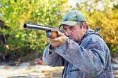 stock photo of hunters  - Hunter taking aim at the target - JPG