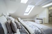 foto of enormous  - Comfy enormous bed in bright bedroom horizontal - JPG