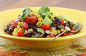 picture of corn  - Southwestern Black bean salad with avocado corn tomato red onion and cilanto in horizontal format - JPG