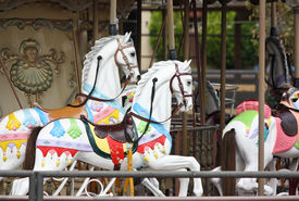 pic of merry-go-round  - White toy horses on a carousel - JPG