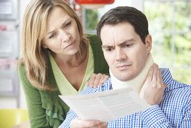 image of neck brace  - Couple Reading Letter In Respect Of Husband - JPG