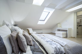 image of enormous  - Comfy enormous bed in bright bedroom horizontal - JPG