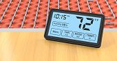 picture of floor heating  - close up view of a floor heating system with a programmable thermostat fahrenheit  - JPG