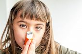 image of inhalant  - Seven year old girl breathing asthmatic medicine healthcare inhaler - JPG