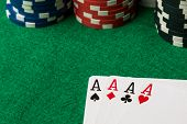 foto of poker hand  - four of a kind poker hand Aces with poker chips - JPG