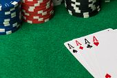 picture of poker hand  - four of a kind poker hand Aces with poker chips - JPG