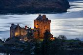 stock photo of castle  - Eilean Donan Castle a castle near to Dornie at the Scottish Highlands. ** Note: Soft Focus at 100%, best at smaller sizes - JPG