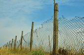 foto of chain link fence  - a dilapidated chain - JPG