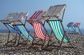 Постер, плакат: Deck chairs in the sun