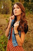 picture of auburn  - cute young woman with long auburn hair in the autumn forest - JPG