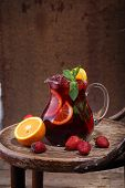 picture of jug  - Jug of wine of Sangrija on a wooden table with an orange and a strawberry - JPG