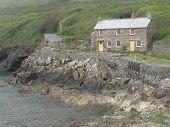 foto of inlet  - House within beach and cliffs coastal inlet seascape photographed at Port Quin in Cornwall - JPG