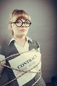 picture of slave  - Afraid businesswoman bound by contract terms and conditions with mouth taped shut - JPG