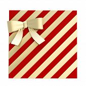 pic of gift wrapped  - Wrapped vinous red gift box with a golden bow and ribbon isolated over white background - JPG