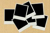 foto of polaroid  - Polaroid picture frame plaste on brown paper - JPG