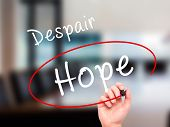 picture of hope  - Man Hand writing and choosing Hope instead of Despair with black marker on visual screen - JPG