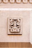 foto of stone sculpture  - stone facade on classical building with ornaments and sculptures - JPG