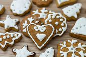 picture of christmas cookie  - Christmas Gingerbread Cookies homemade on wooden table - JPG