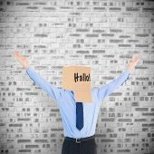 picture of anonymous  - Cheering anonymous businessman against grey brick wall - JPG
