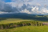 picture of cloud forest  - Scenic top view on the valley forest and mountains on the background of the sky with clouds on a sunny day - JPG