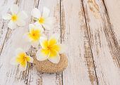 picture of stone-therapy  - Tropical Plumeria and stone therapy on wooden table for spa and wellness concept - JPG