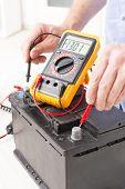 image of  multimeter  - Testing car battery with digital multimeter - JPG