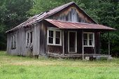 stock photo of abandoned house  - old abandoned house in a rural setting - JPG