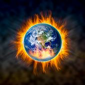 image of doomsday  - Globe catching fire in doomsday concept Elements of this image furnished by NASA - JPG