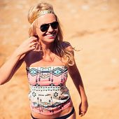 image of hippy  - Pretty young hippie caucasian girl enjoys good weather and the hot sun on a beach - JPG