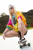 foto of nose ring  - Pretty blond girl riding skateboard - JPG
