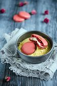 pic of chickpea  - Makarons of chickpeas with pistachio cream on wooden background - JPG