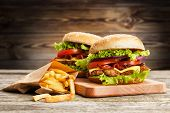 picture of hamburger-steak  - Delicious hamburger and french fries on wooden background - JPG