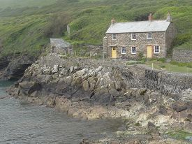 picture of inlet  - House within beach and cliffs coastal inlet seascape photographed at Port Quin in Cornwall - JPG
