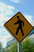 picture of pedestrian crossing  - The pedestrian crossing sign in front of an office building - JPG